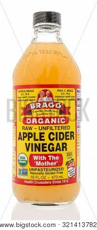 Winneconne, Wi - 10 September 2019: A Bottle Of Bragg Apple Cider Vinegar With Mother On An Isolated