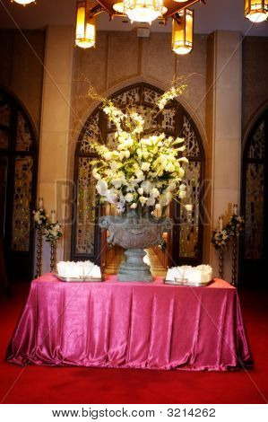 Table Setup With Flowers And Wedding Programs