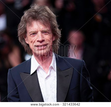 Mick Jagger walks the red carpet ahead of the