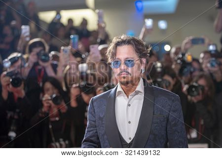 Johnny Depp walks the red carpet ahead of the ''Waiting For The Barbarians'' screening during the 76th Venice Film Festival at Sala Grande on September 06, 2019 in Venice, Italy.