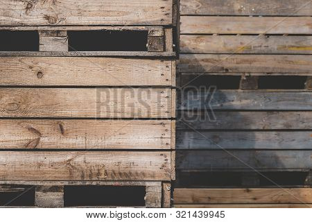 Storage Wooden Bins For The Transportation Of Fruits And Vegetables. Background Of Wooden Crates. Wa