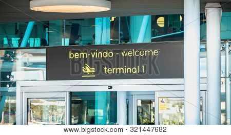 Exterior View Of Lisbon International Airport Where Travelers Walk