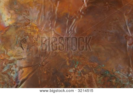 Abstract Image Of Rainbow Hued Copper