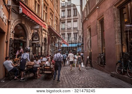 Lyon, France - July 13, 2019: Traditional French Restaurant In Lyon Seen From A Street From Old Lyon