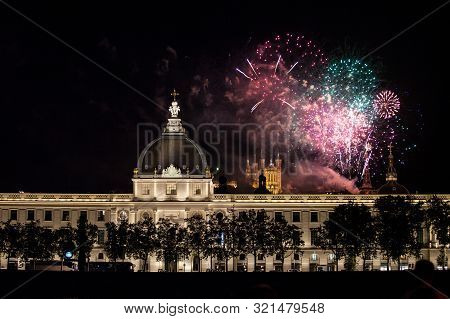 Lyon, France - July 14, 2019: Fireworks Bursting Over Hotel Dieu In Lyon For French National Holiday