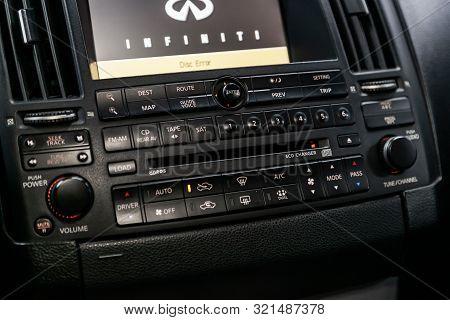 Novosibirsk, Russia - August 24, 2019:  Infiniti Fx, Modern Black Car Interior: Climat Control View
