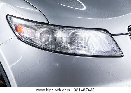 Novosibirsk, Russia - August 24, 2019:  Infiniti Fx,  Macro View Of Modern Silver Car Xenon Lamp Hea