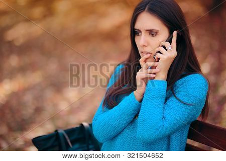 Worried Woman Receiving A Phone Call With Bad News