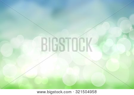 Abstract Bright Spring Or Summer Landscape Texture With Natural Light Green Bokeh Lights And Blue Br