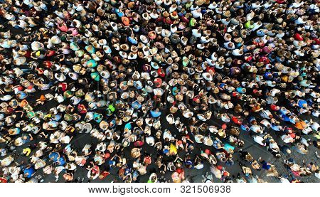 Aerial. Many People Background. Top View From Drone.