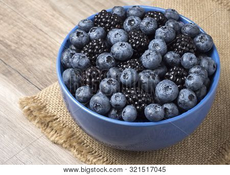 Forest Berries (blueberry,bramble) In A Ceramic Blue  Bowl. Top View.