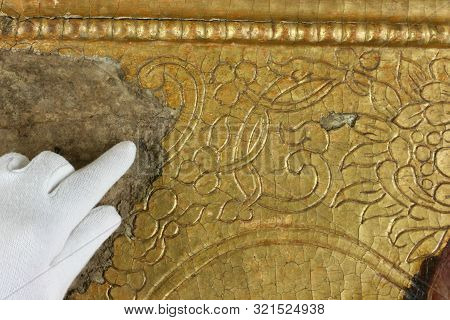 Restoration: Gold Restoration, Old Icon. Close Up. Conservation Of Paintings. Conservation Of Sculpt