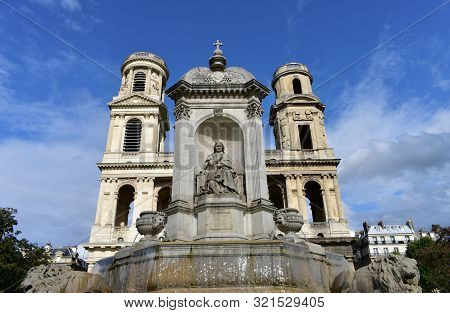 Church of Saint Sulpice neoclassical facade with fountain. Paris, France. poster