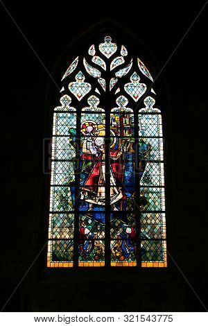 A Detailed View Of Stained Glass Windows In The Church Of Saint Germain In Rennes In France