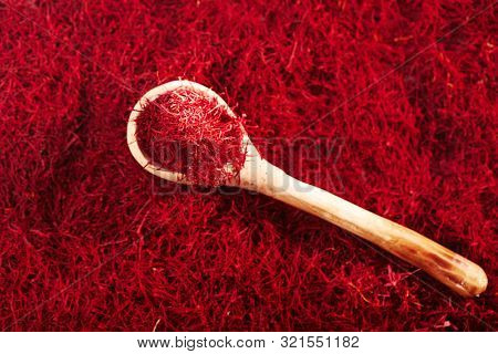 saffron threads  with vintage spoons, truly color, soft focus