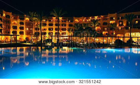 Hurghada / Egypt. 30 July 2018:  Swimming Pool And Evening Hotel On Holidays. People Relax In Evenin