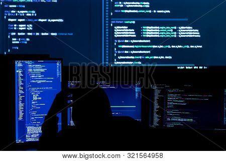 Unknown Software Developer Freelancer Work With Program Code C++ Java Javascript On Wide Displays At