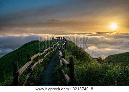 Picturesque View From The Mountain Height To The Thick Clouds At Sunrise. Kumamoto, Japan.