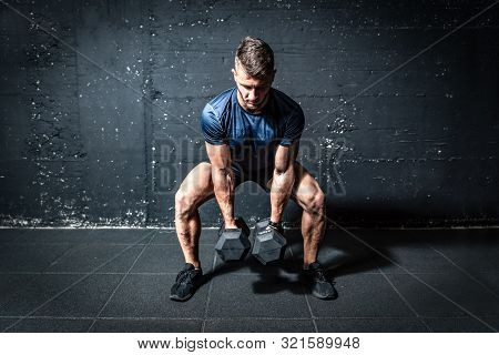 Dumbbells Weights Training, Young Strong Fit Muscular Sweaty Man With Big Muscles Strength Cross Wor