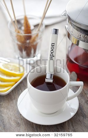 cup of tea, cookies and lemon on a blue table