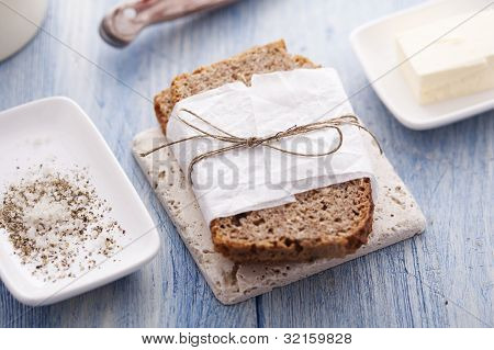 wholemeal bread with salt, pepper and butter
