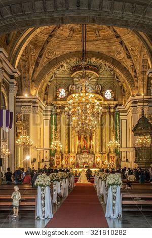 Manila, Philippines - March 5, 2019: San Augustin Church. Shot From Entrance: Hall Under Bowing Ceil