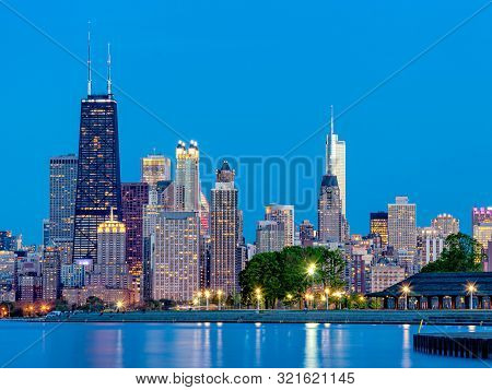 City Urban Skyline At Night. Cityscape Of Chicago From Lakefront Lake Michigan.