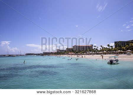 The Beach Front Of The High Rise Resort Area In Aruba