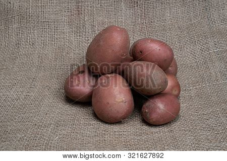 Potatoes. Fresh Potatoes. Potatoes On A Jute Bag With Natural Product Appearance For Product Food Ph