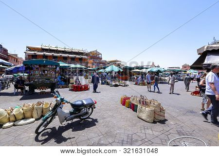 Street Vendors And Tourists In Jamaa El Fna Square