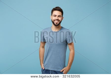 Young Smiling Handsome Man In Casual Clothes Posing Isolated On Blue Wall Background, Studio Portrai
