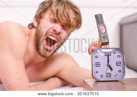 Man Bearded Annoyed Sleepy Face Lay Pillow Near Alarm Clock. Break Discipline Regime. Stop Ringing.