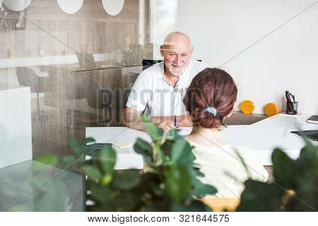 Middle Aged Business Man In The Office Having Conversation With New Client. Business Concept.