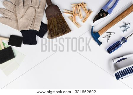 The Tools and equipment, necessary to do weekend Chores, laid out on a white table with copy space.