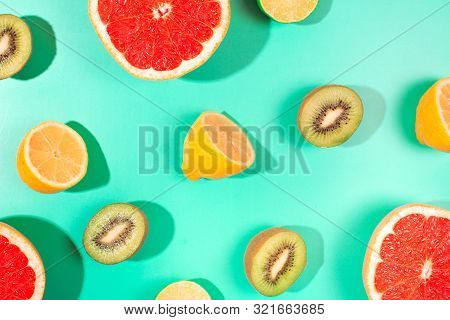 Fruits On Trendy Green Background. Flat Lay Style.
