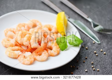 Shrimps Served On Plate With Lemon, Herb, Pepper On White Plate / Boiled Peeled Shrimp Prawns Cooked