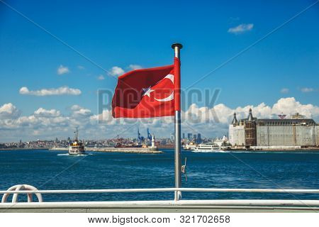 Istanbul, Turkey: Turkish Flag And Ferry Boat, Istanbul Cityscape. Sea Voyage On The Old Ferryboat F