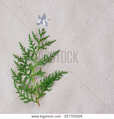 Christmas Tree Made Of Thuja Branches And Decorations Star On Rustic Background. New Year Concept. F
