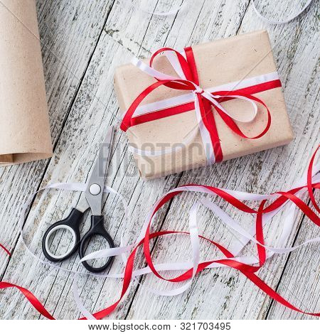 Celebratory Concept - Set With Handmade Present Box In Kraft Paper, Wrapping Tools, Packing Paper On