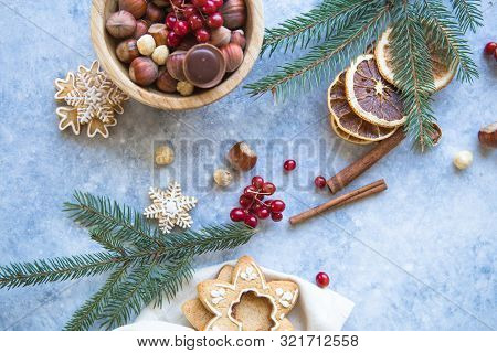 New Year And Christmas Background. Christmas Candy Cane Gingerbread On Blue Background. New Year And