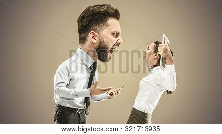 Angry Businessman Screaming At Employee In The Office. Caucasian Woman Is Under The Pressure And Agr