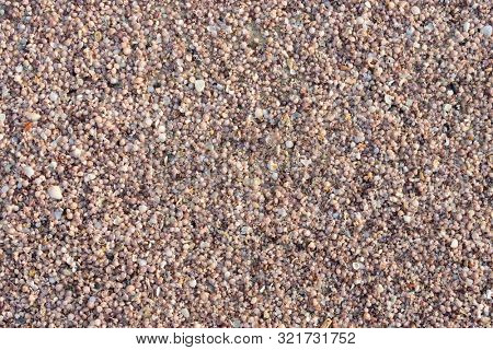 Background of shell and coral mixed sand of a tropical beach in Thailand