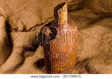 Decoupage Decorated Old Bottle On A Sackcloth