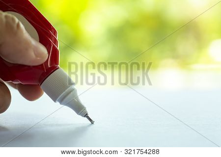 Woman's Holding Blue Liquid Correction Writing Pen Or Liquid Paper For Correct Hand Writing Mistakes