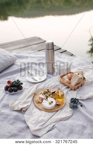 Picnic On The Lake: Fresh Eggs, Sandwiches From Ciabatta With Olives, Camembert Cheese With Figs And