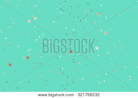 Green Mint Background With Rose Gold Glitter And Metallic Stars. Flat Lay Style