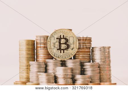 Bitcoin(btc) Coin On Coins Stack. Virtual Cryptocurrency Mining. Bitcoin Revolution. Money Launderin