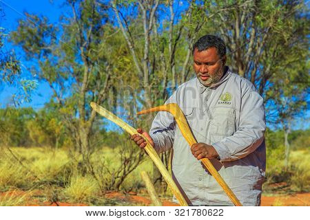 Kings Creek Station, Northern Territory, Australia - Aug 21, 2019: Aboriginal Australian Man Holding