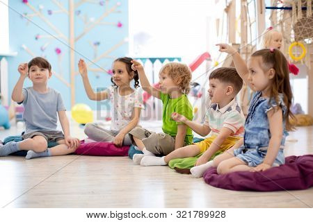 Preschool Children Play On Speech Therapy Lesson In Kindergarten Or Primary School
