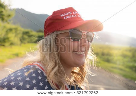 Wenatchee, Washington - July 4, 2019: Cute Republican Woman Wearing A Maga Hat (make America Great A